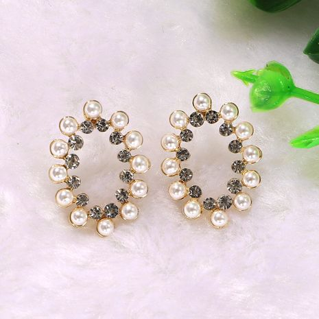 boho style pearl silver transparent rhinestone inlaid geometric oval hollow earrings wholesale nihaojewerly NHJQ243071's discount tags