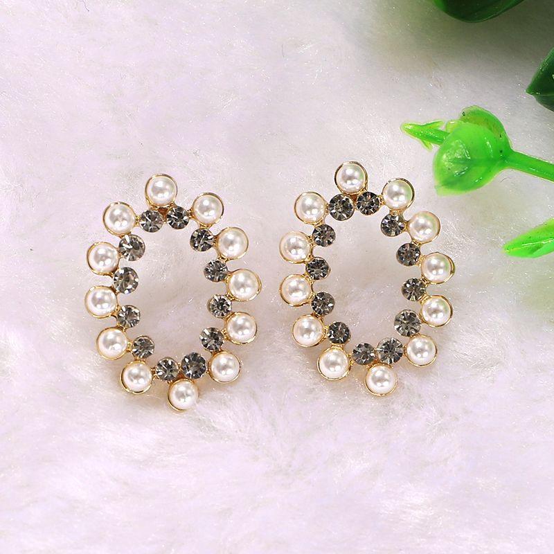 boho style pearl silver transparent rhinestone inlaid geometric oval hollow earrings wholesale nihaojewerly NHJQ243071
