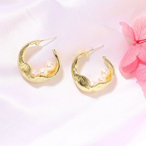 The new bumpy wave shape inlaid pearl round hollow metal earrings wholesale nihaojewerly NHJQ243074's discount tags
