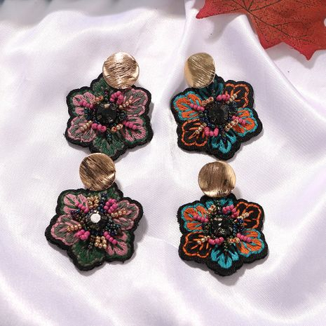 Geometric metal disc color rice beads inlaid embroidery ethnic style earrings wholesale nihaojewerly NHJQ243078's discount tags