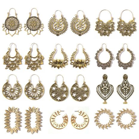 Bohemian ethnic carved rotating hollow flowers retro earrings wholesale nihaojewerly NHGY243095's discount tags