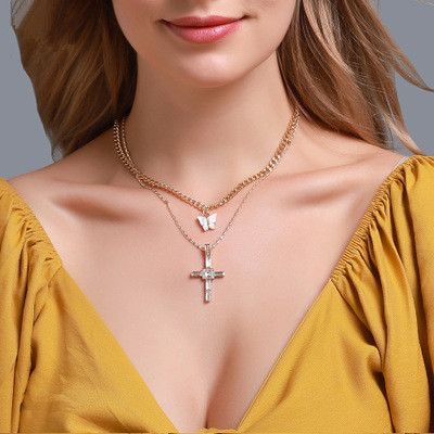 nouveau long collier créatif petit papillon croix lettre pendentif chaîne de pull multicouche en gros nihaojewelry NHMO240361's discount tags