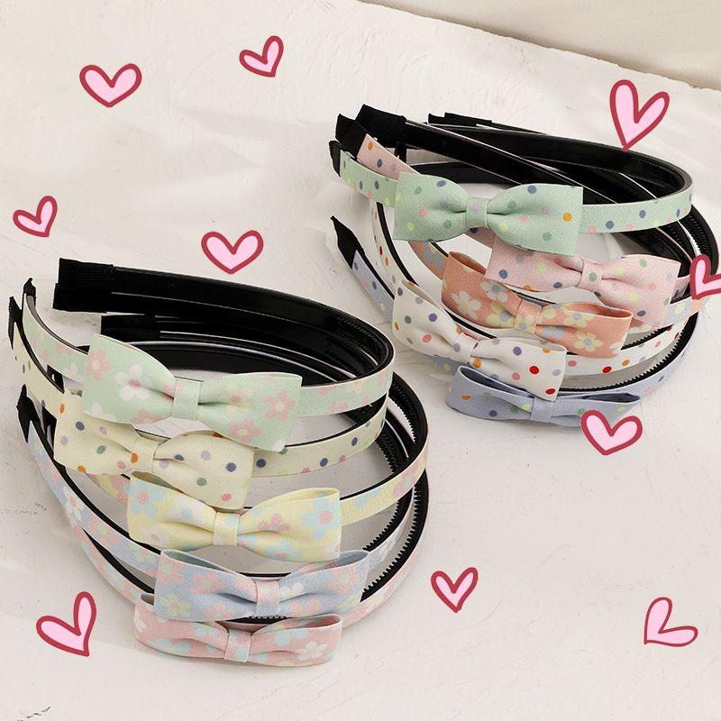 new fashion  chiffon fabric bow tie polka dot  sweet  headband  NHNU243382