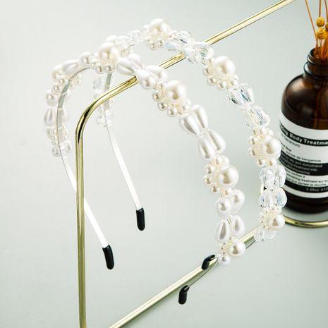 Korean hot selling crystal pearl headband simple fashion headband wholesale  NHLN243466's discount tags