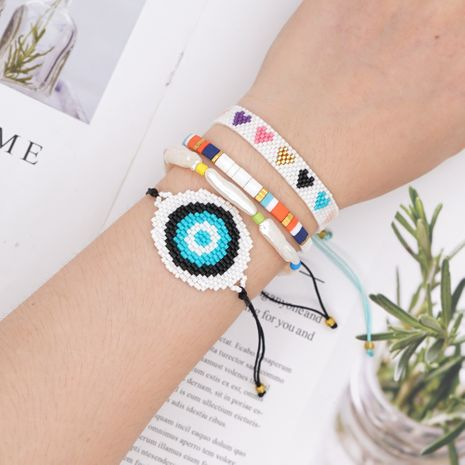 fashion natural pearl rice beads hand-woven eyes ethnic style bracelet NHGW243591's discount tags