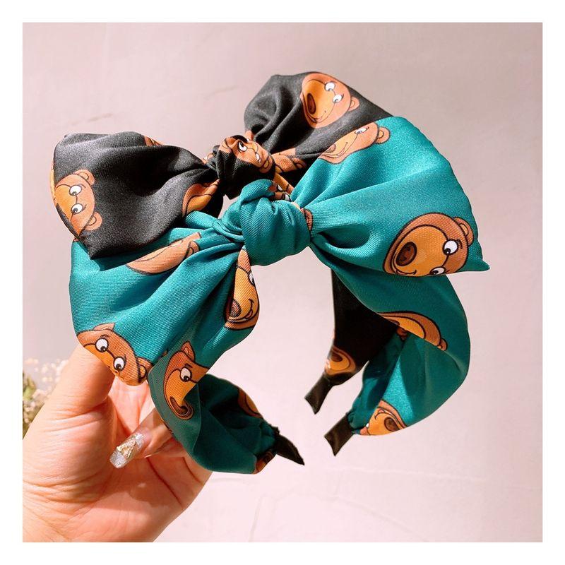Korea retro cartoon style bear cute bow  headband wholesale  NHHD243657