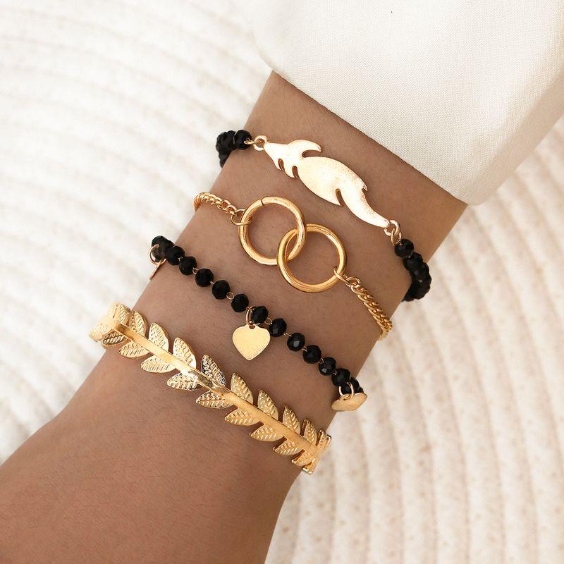 new style black beaded metal leaf double ring love pendant tassel 4 four-piece bracelet NHPV243684
