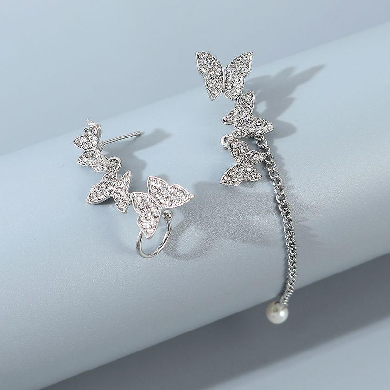 Korean fashion allmatch asymmetric small butterfly earrings for women wholesale NHPS243737