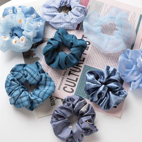 Korean daisy large intestine hair ring simple elegant girl ponytail hair scrunchies wholesale nihaojewelry NHNU243402's discount tags