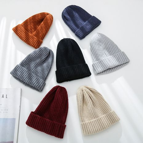 Pure color wild knit outdoor winter new thick warm woolen  hat cap NHTQ243903's discount tags
