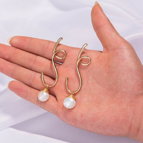 new simple creative special-shaped ear needles hand-woven natural pearl earrings wholesale nihaojewelry NHAN244438's discount tags