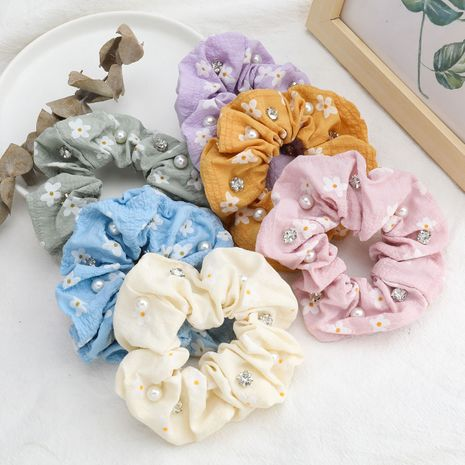 Korea's hot sale small white flower printed fabric diamond-studded pearl hair scrunchies wholesale  NHJE244479's discount tags