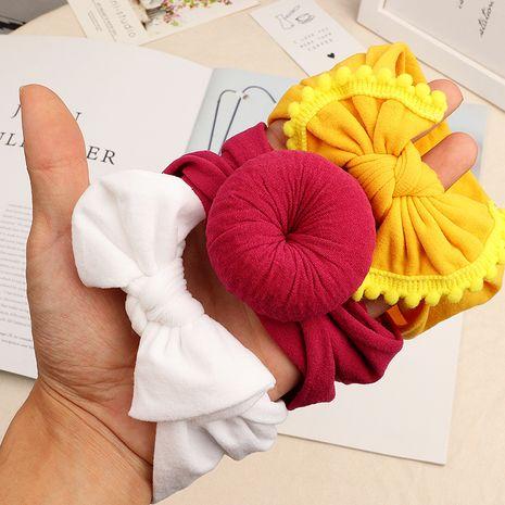 Couvre-chef en trois pièces pour enfants en tissu doux bandeau de bébé simple couleur unie arc accessoire de tête de bébé en gros NHNU244689's discount tags