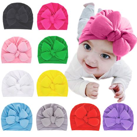 children's hats fashion double bowknot pullover cap solid color wholesale nihaojewelry NHWO244722's discount tags