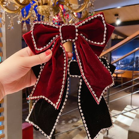 Korean new black red big bow hairpin edge diamond back head clip wholesale NHMS245274's discount tags