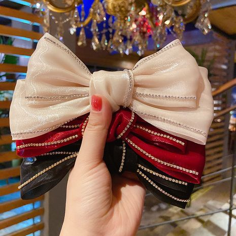 New fashion flashing diamond skirt mesh silk cloth mercerized fabric bow hairpin wholesale nihaojewelry NHMS245283's discount tags