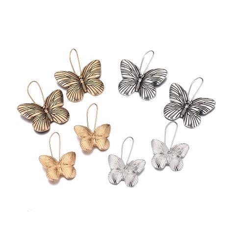 vente chaude alliage rétro simple boucles d'oreilles papillon insecte en gros nihaojewelry NHOA245696's discount tags