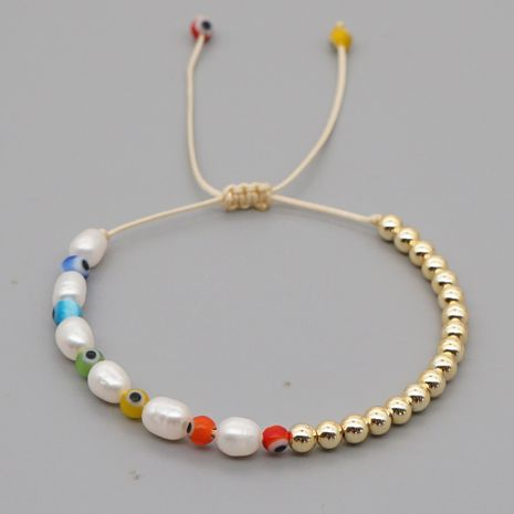 hot-selling hand-woven natural pearl yoga seven chakra eyes imported gold bead color preservation bracelet  NHGW245868's discount tags
