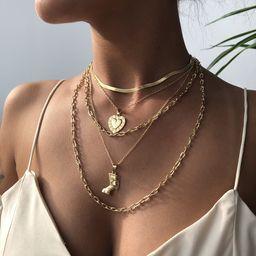 Collar de cadena de clavícula de aleación de múltiples capas de tendencia irregular en forma de amor de moda al por mayor NHMD246190