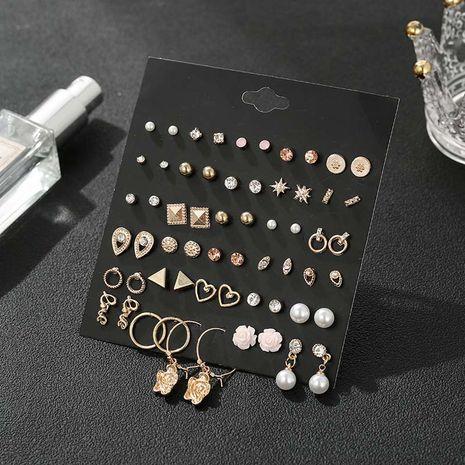 Nouvelle mode en alliage de fleur d'or placage de simples boucles d'oreilles rétro mis en gros NHSD246237's discount tags