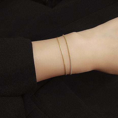 Double Flat Snake Rice Bead Chain Golden Wild  simple Titanium Steel Bracelet wholesale NHOK246280's discount tags