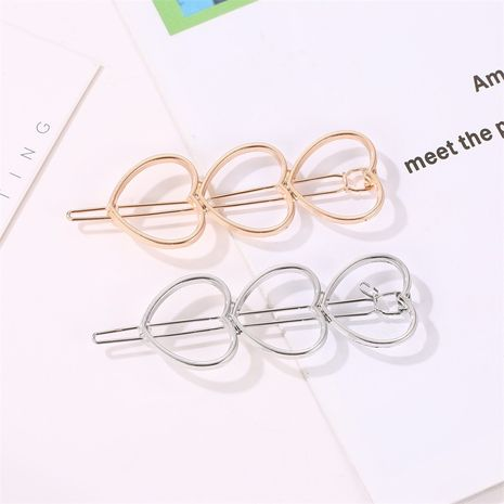 Korean fashion metal hairpin simple hollow three peach heart bangs hairpin Wholesale nihaojewelry NHDP246043's discount tags