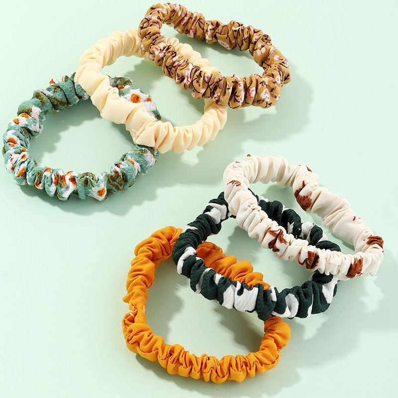 new cute flower hair ring fabric large intestine ring tie horsetail head rope wholesale  NHAU246583