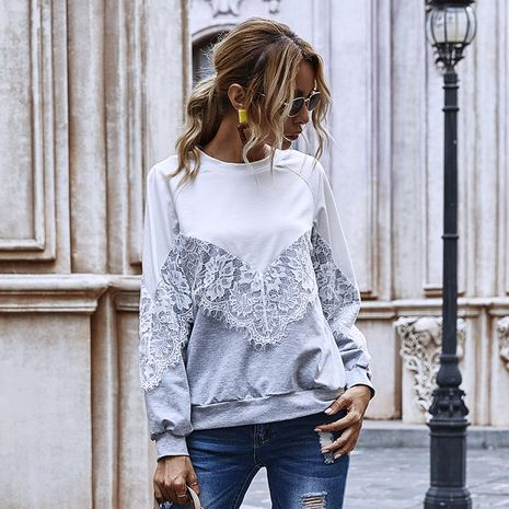 Moda color sólido costura encaje hueco regular manga larga cuello redondo top para mujer NHDF246764's discount tags