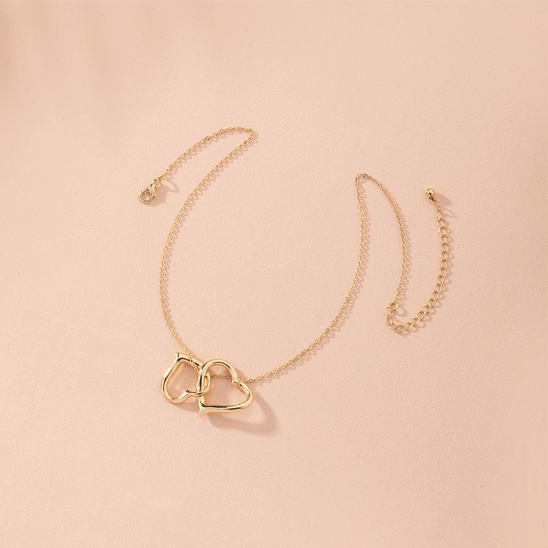 fashion new love heart hollow retro niche item decoration alloy sweater chain for women wholesale NHAI246846