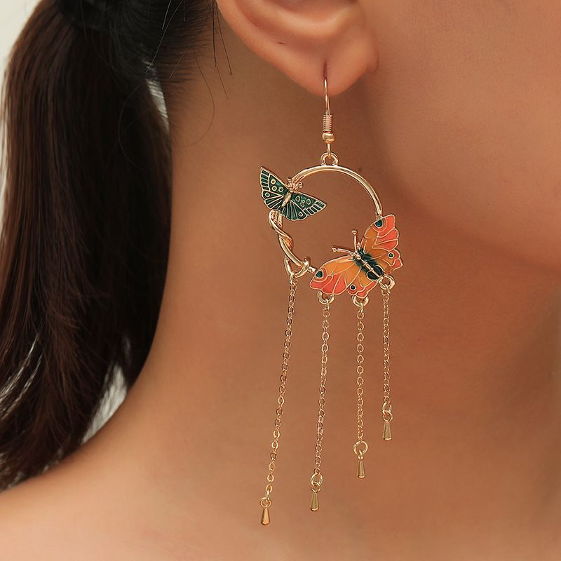 Korea fashion trend ethnic long tassel retro exaggerated drip butterfly thin alloy earrings NHKQ246951