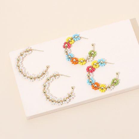 Boucles d'oreilles pour femmes bohèmes de niche de perles de riz en forme de C de fleurs faites à la main NHRN247010's discount tags