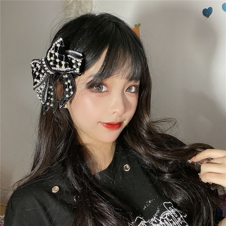 Korea retro sweet pearl bow hairpin clip hair accessories headdress wholesale NHYQ247066's discount tags