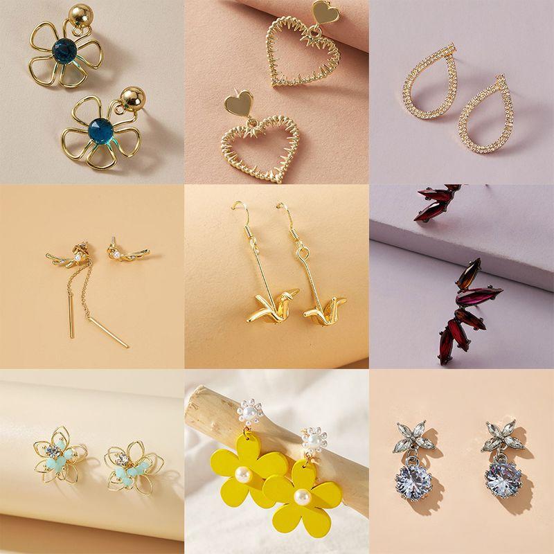 fashion  wild love butterfly flower geometric alloy earrings  NHGY247102