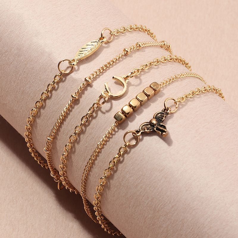 wholesale simple geometric tassel chain jewelry leaf Ushaped bracelet combination NHNZ247152