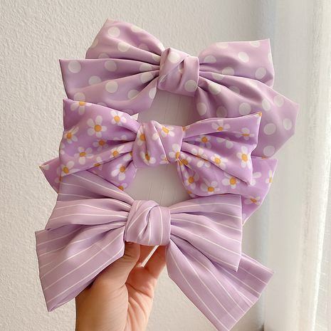 Korea new sweet girl big bow hairpin side clip wholesale nihaojewelry NHCQ247279's discount tags