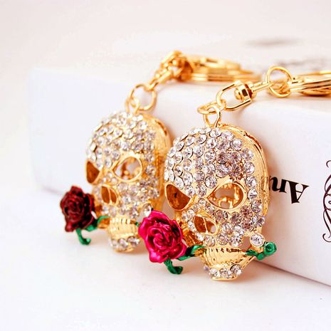 Wholesale diamond-studded death rose skull car keychain  NHAK247581's discount tags