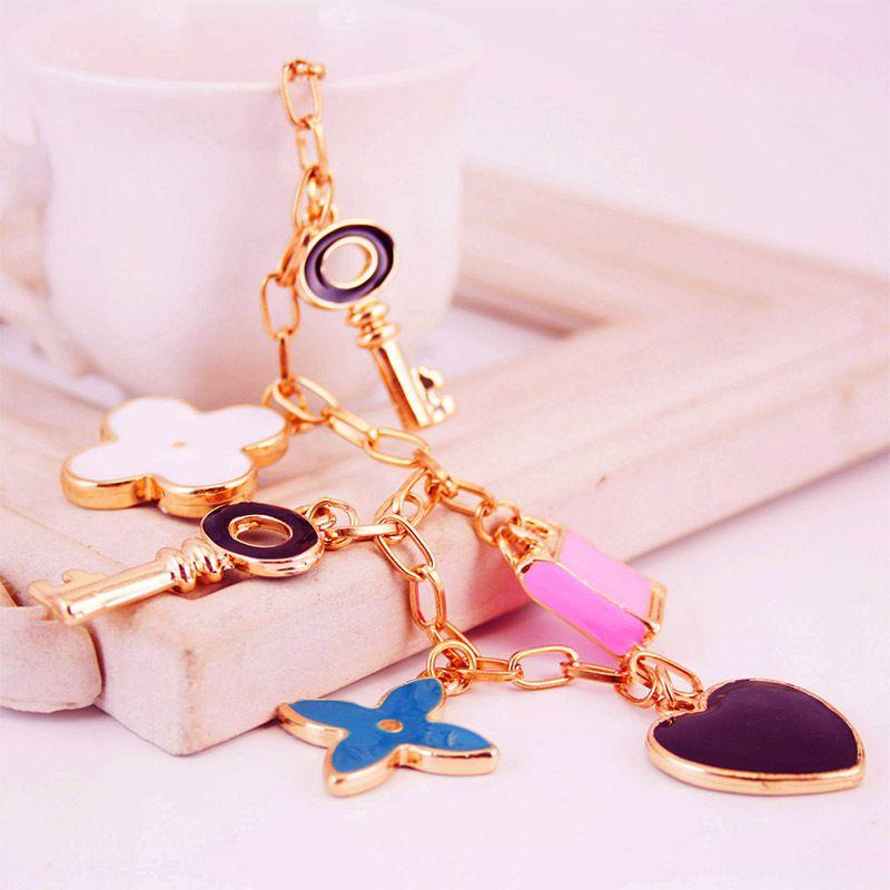 boutique four-leaf clover women's bag accessories metal pendant key chain NHAK247586