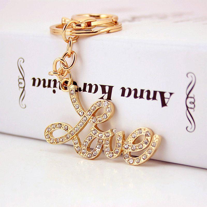 Korean diamond letters LOVE women's bag accessories couple car key chain  NHAK247591