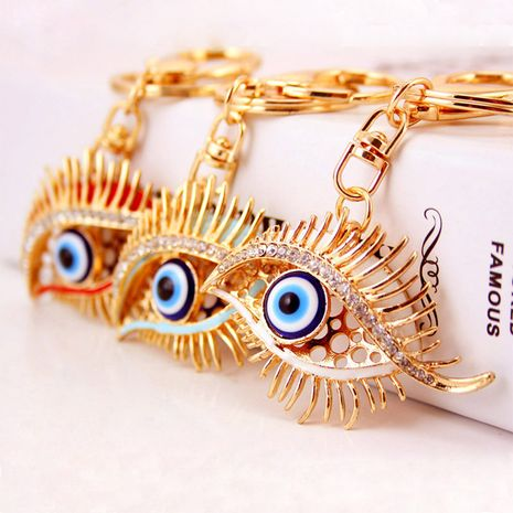 Korean diamond-studded Devil's Eye Crystal Metal Pendant Eyelashes Keychain  NHAK247605's discount tags