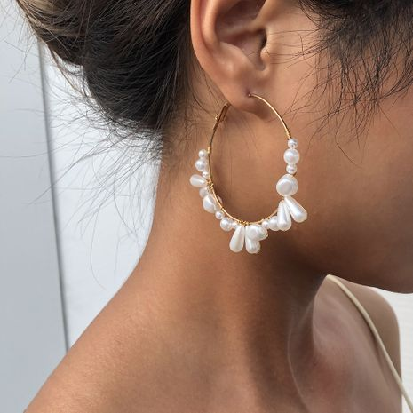 woven pearl exaggerated fashion circle alloy earrings for women hot sale NHMD248036's discount tags