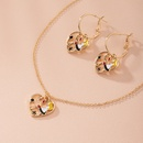 fashion exaggerated ethnic portrait style metal stitching combination alloy necklace earrings set wholesale NHAI248067