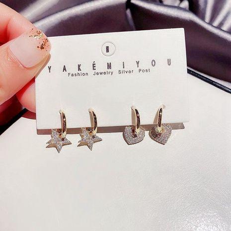Conjunto de aretes de cobre de estrellas de cinco puntas con incrustaciones de circonitas simples y llenas de diamantes coreanos NHCG248344's discount tags
