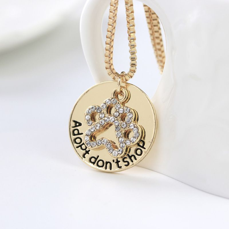 HotSelling Adopt Hollow Diamond Dog Paw alloy Necklace for women NHMO248511