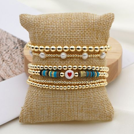 Fashion trend natural pearl soft ceramic multi-layered beaded imported color-preserving gold bead letter bracelet NHGW249693's discount tags
