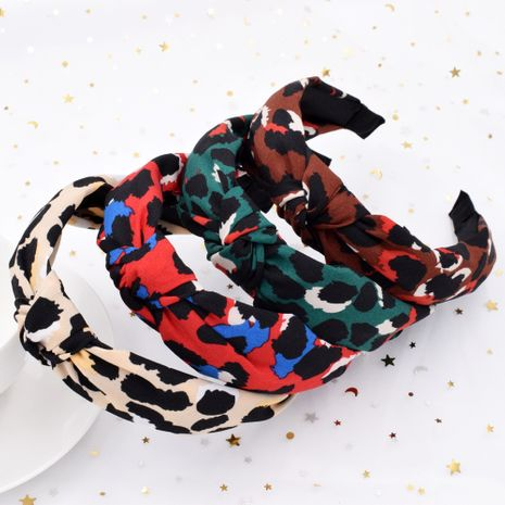 exaggerated leopard print retro cross headband creative fabric knotted headband wholesale NHCL249985's discount tags