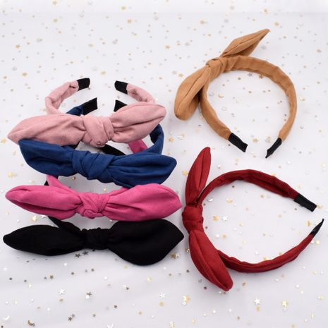 Tela de orejas de conejo de terciopelo anudado color sólido simple diadema de prensa de lado ancho al por mayor NHCL249993's discount tags