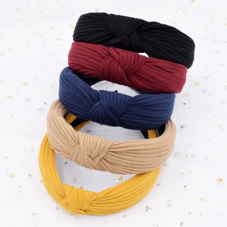 Wide-sided knitted striped cross-knotted headband Korean fabric simple headband wholesale NHCL249994's discount tags