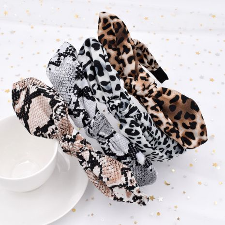 Leopard print snakeskin print rabbit ears fabric wide brim knotted leopard print headband wholesale NHCL250014's discount tags