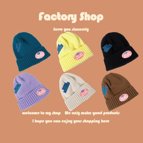 Embroidered letter woolen hat big hood adult elastic warm hat wholesale nihaojewelry  NHTQ250340's discount tags
