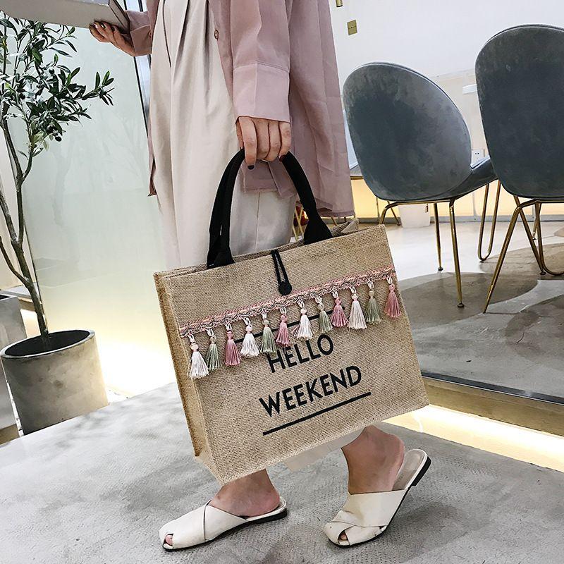 new  large capacity portable Korean linen oneshoulder tassel tote bag wholesale NHLH250613